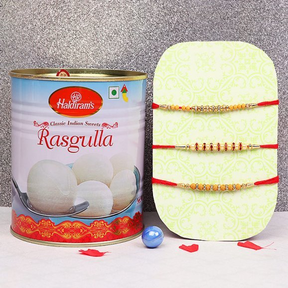 Three Rakhis Set with One Kg Rasgulla Gift Combo