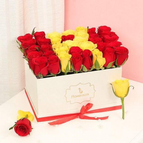 Red and Yellow Roses in a White Box