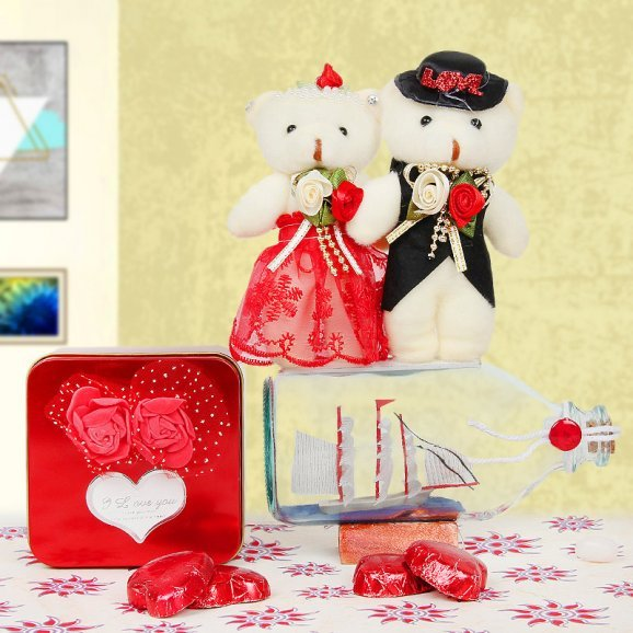 Chocolates and teddy with a sailing ship combo