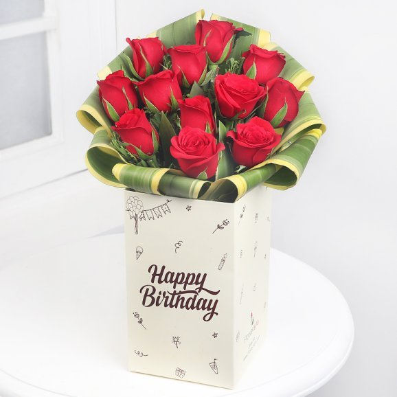 12 Red Roses in Floweraura Birthday Box