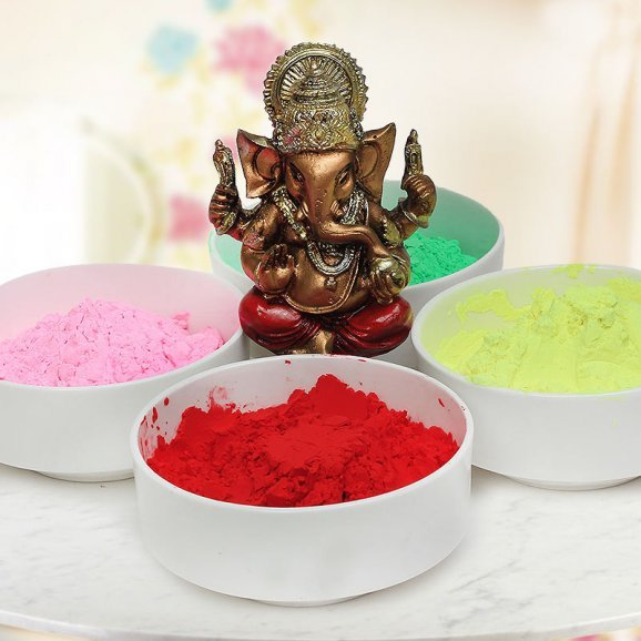 A combo includes four packs of herbal Gulals and A 3 inches lord?Ganesha