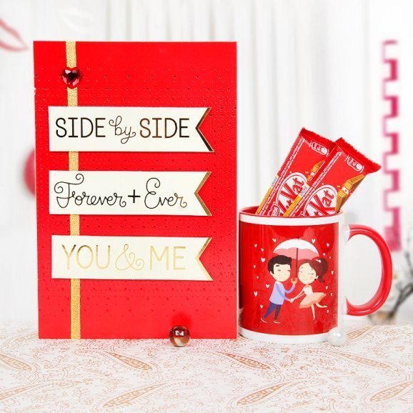 A love card and a mug with 2 kitkats
