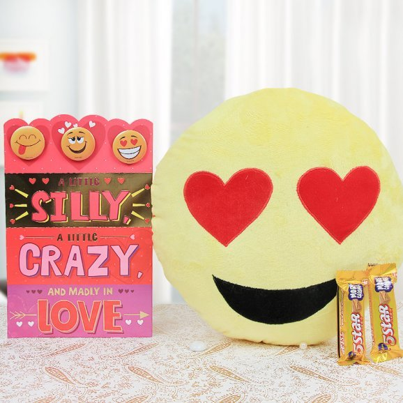 A cushion with greeting card and two 5 star chocolates