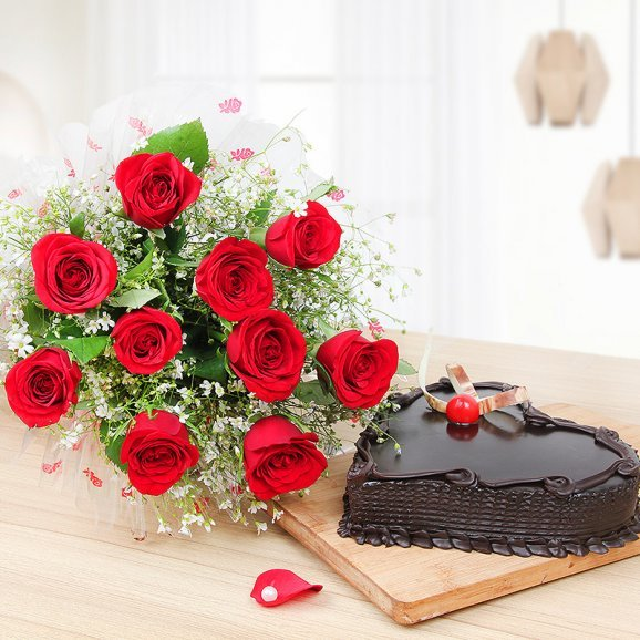Surprising Heartilicious Combo - 10 Red roses with 1/2 kg heart shaped chocolate cake