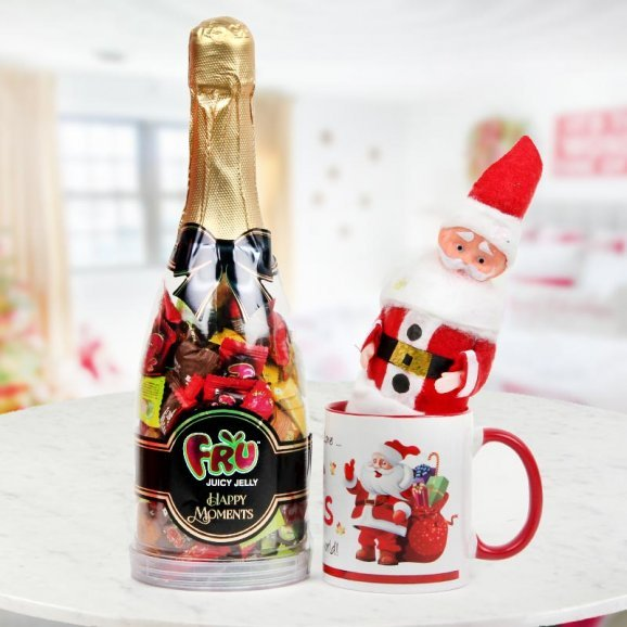 Little 6 inch miniature Santa, a Happy Santa Mug and a champagne shaped bottle filled with candies