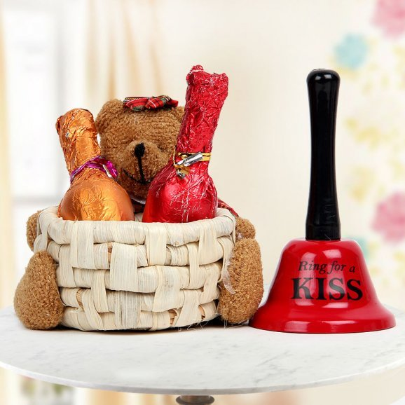 A Teddy basket Two champagne shaped handmade chocolates and A Ring for a Kiss bell
