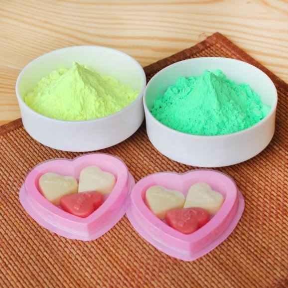 A combo of Yellow and green Gulal and Packs of two heart shaped handmade chocolates