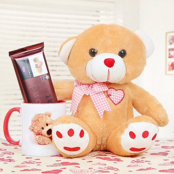 A 6 Inches Teddy with a Mug and a Chocolate