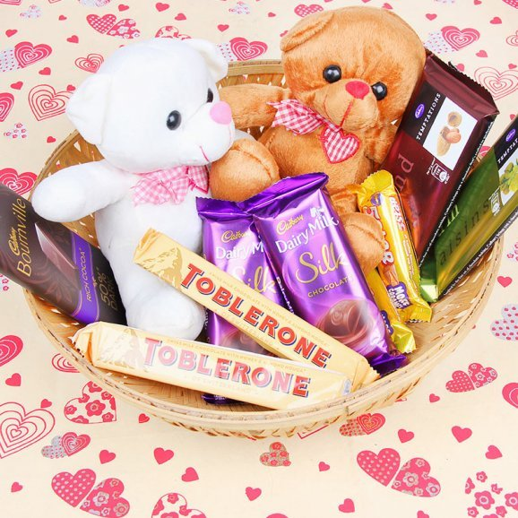 Bunch of chocolates and couple of 6 inches teddies