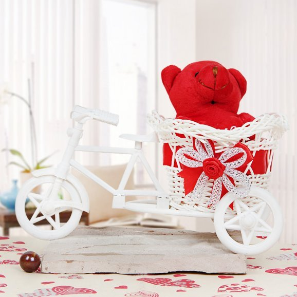 A 3 Inch Teddy in a Cycle Toy