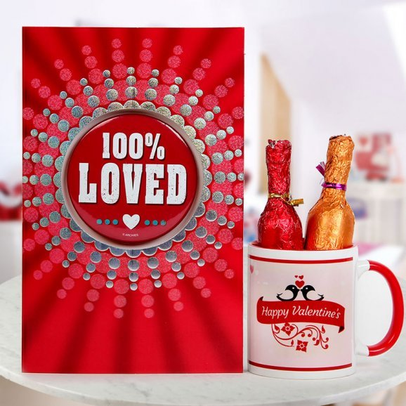 A Love Card A Happy Valentines Mug and Two champagne shaped bottles of chocolates
