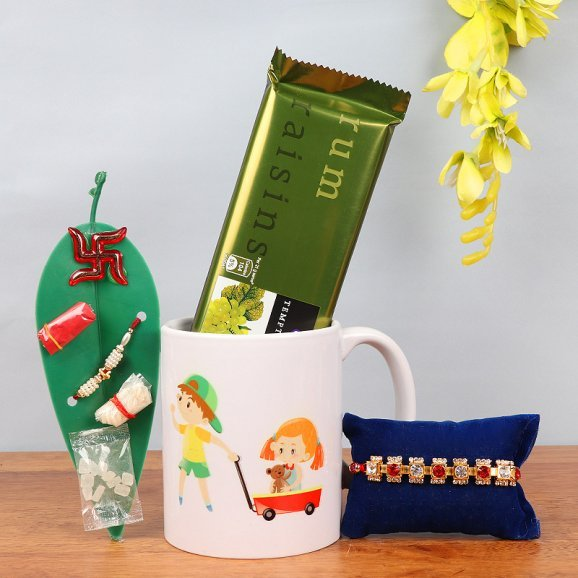 Rakhi with Cadbury Temptaion and Printed Mug alongwith a Leaf