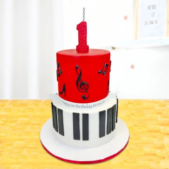 Two tier piano cake for one year old