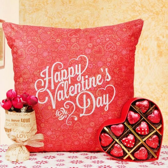 A cushion and chocolates with artificial flowers bouquet combo