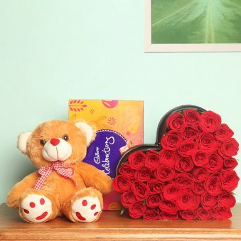 35 Red roses hearshaped 12 inches cream colored teddy cadbury celebation