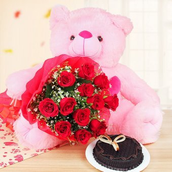 Adorable Expressions - A gift hamper of 22-inches pink teddy bear, 12 red roses bunch, half kg chocolate truffle cake
