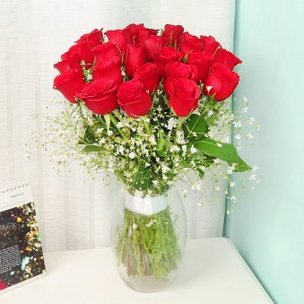 24 Red Roses in Glass Vase on Table
