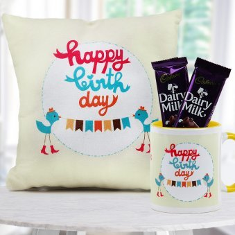 """Happy Birthday"" quoted cream color cushion and ceramic mug with 2 Cadbury dairy milk chocolates"