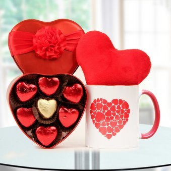 A box of heart-shape handmade chocolates A red heart cushion and A Coffee Mug
