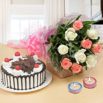 An Alluring Hamper of 10 white, 10 pink roses, 2 decorated diyas, half kg German Blackforest cake