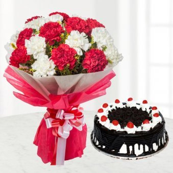 A Bunch of Red and White Carnations with Blackforest Cake