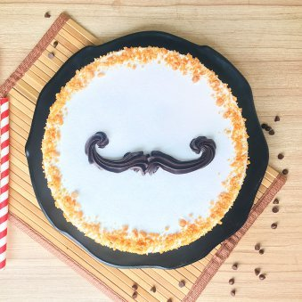 Macho mustache butterscotch cake