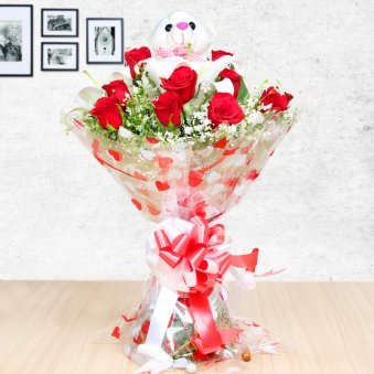 Flowery Teddy - Combo of 12 red roses with 3 white lillies and a 6 inches teddy