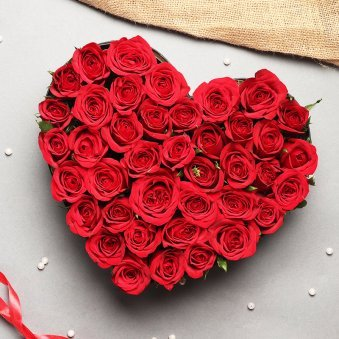 Basket Of 35 Red Roses Packed Beautifully In The Shape Heart
