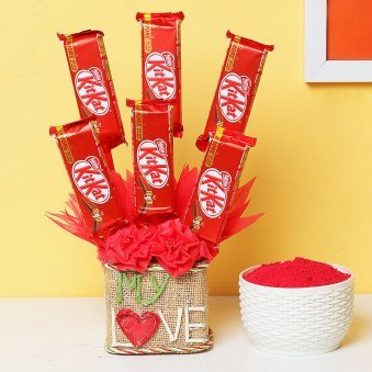 Beautiful arrangement of kitket chocolates with gulal