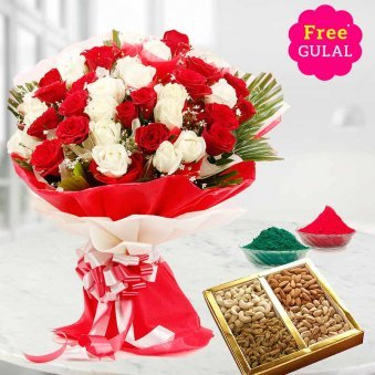 Bouquet of white and red flowers with dry fruit and gulal for Holi