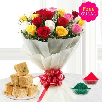 Yellow, white, red and pink flowers bunch with Soan papdi and gulal for Holi