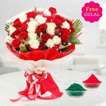 Beautiful Holi bouquet of red and white flowers with gulal