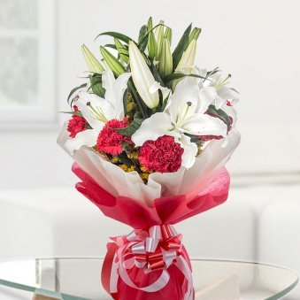 2 White Lilies and 12 Red Carnations on Table