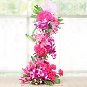 6 Pink Lilies 30 Pink Carnations and 20 Orchids