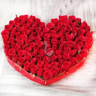 Rhythm divine - 100 red roses heart shaped bunch