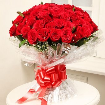 Romantic Thrill Pretty Bunch Of 50 Red Rose flowers with green leaves - delivery in Delhi