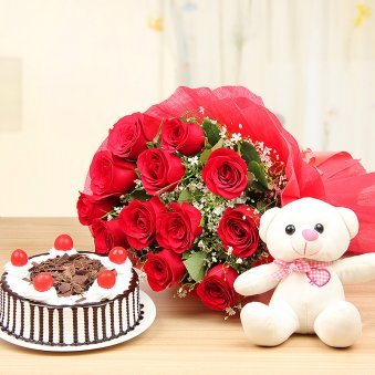 Lady Charmers Ultimate combo of Teddy Cake and 12 Red rose flowers - delivery in Delhi