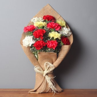 Bunch of Mixed Carnations in Jute Packing