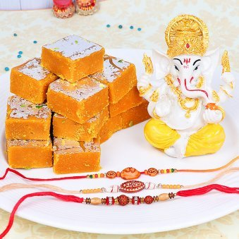 Three Divine Rakhis with Ganesha Idol and Besan Barfi Gift Combo