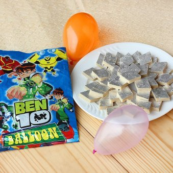 A combo having pack of delicious Kaju Barfi and a pack of colourful balloons