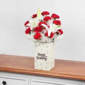12 Red Carnations and 2 Lilies in Birthday Box