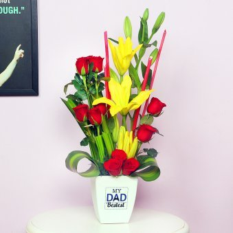 Roses and Lilies in a Plastic Vase for Dad