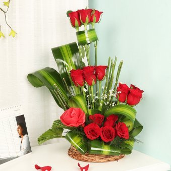 Basket Arranagement of Eighteen Red Roses