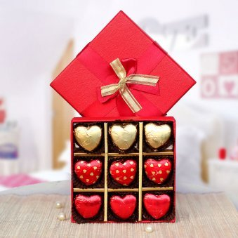 A beautiful box of 9 heart shaped handmade chocolate