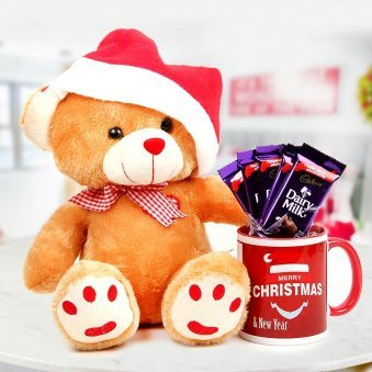 12 inches cuddly teddy bear with the classic Santa hat with a Merry Christmas Coffee Mug and a set of 5 Dairy Milk