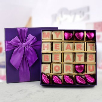 A Box Of 25 Handmade White Chocolate With Message My Heart Beats For You