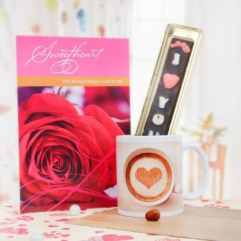 A greeting card with a mug and handmade chocolates
