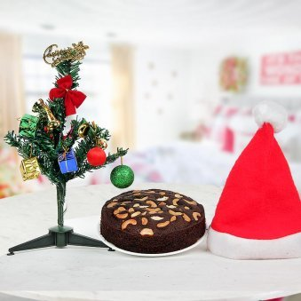 Classic Santa Cap with a rich dry fruit stuffed 1/2 kg Christmas Plum Cake plus 1 feet embellished miniature Christmas Tree