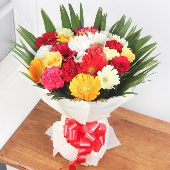 9 Mixed Carnations 4 Red & Yellow Roses and 9 Mixed Gerberas with Closed View