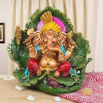 Divine Ganesha sitting on a leaf